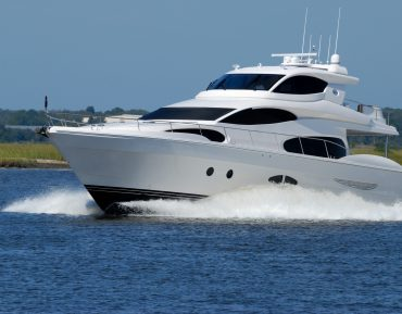 white-yacht-on-running-on-blue-body-of-water-during-daytime-163236