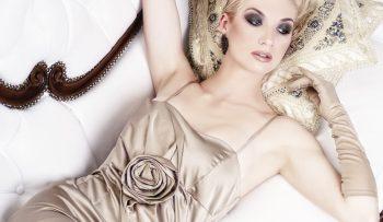 Beautiful blond woman lying on luxury sofa